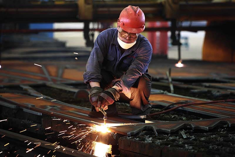 A worker welds steel in a factory in Huaibei, in north China's Anhui province on July 24, 2013.  China's manufacturing activity contracted to a 11-month low in July, an HSBC survey showed on July 24, the first evidence of the Asian economic giant losing further momentum in the third quarter.   CHINA OUT     AFP PHOTO
